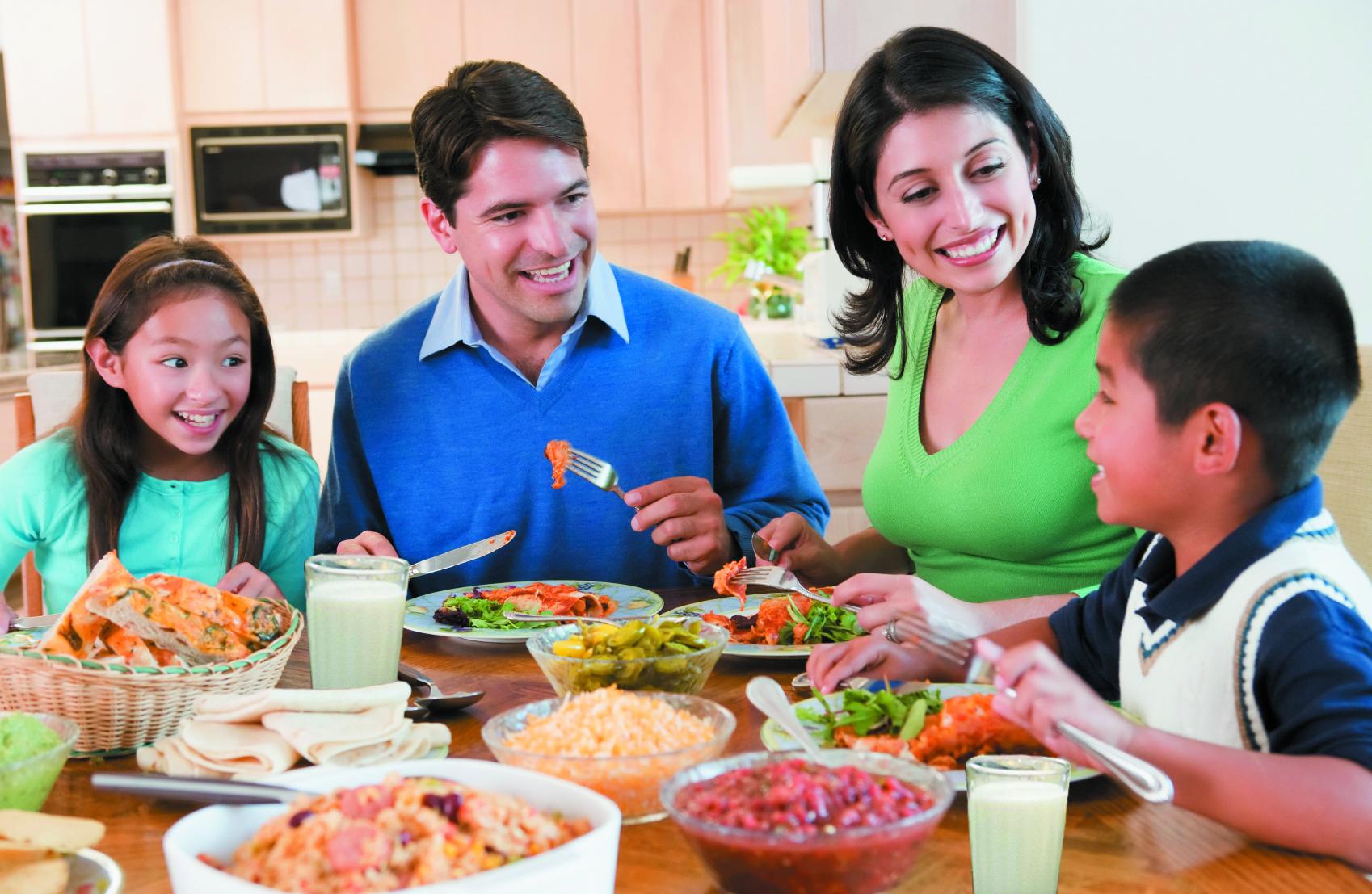 Family Enjoying Mealmealtime Together