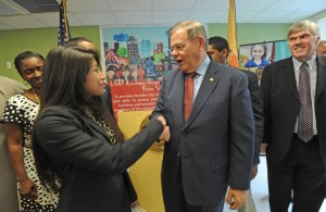 At LEAP Academy in Camden, NJ, a press conference to announce the three students from Camden who will be participating in the Congressional Hispanic Caucus Institute's Ready to Lead NextGen program.   Here, US Senator Robert Menendez shakes the hand of Michelle Panchana, who will be participating in the R2L program. ( APRIL SAUL / Staff )